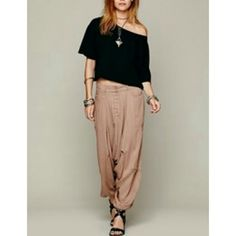 Free People Slouchy Harem Pant The?Free People Harem Tie Pants?are made from a soft, woven fabric with a lustrous finish. The blushing pink shade brings femininity to the cropped, relaxed design.? Material: 52% Cupro & 48% Tencel Color: Vintage Rose Free People Pants Capris