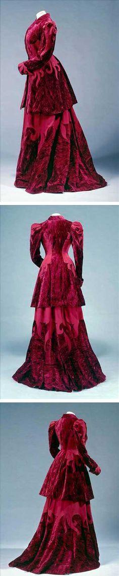 Suit, 1897-1900. Long curved basque jacket and collar, shaped skirt with sweeper. Wool and crushed velvet burgundy. Galliera Musée de la Mode de la Ville de Paris