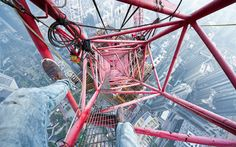 Thrillseeker Ivan Kuznetsov looking down on the 101-floor Shanghai World Finance Center.