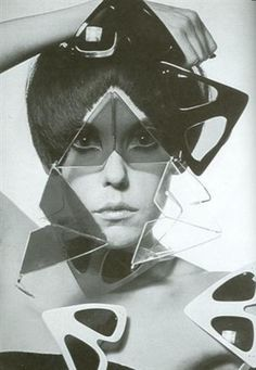 """Retro futuristic avant garde triangle glasses - """"Peggy Moffitt (born 1940) was a premier model during the 1960s. She developed a signature style that featured heavy, Kabuki-like makeup and an asymmetrical hair cut."""""""