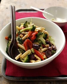 A high proportion of vegetables turns this pasta salad into a light, nutritious meal.
