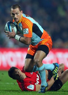 Aaron Cruden of the Chiefs is tackled by Dan Carter of the Crusaders during the round 15 Super Rugby match between the Chiefs and the Crusaders at Waikato Stadium on May 24, 2013 in Hamilton, New Zealand.