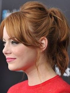 #3 - Emma Stone medium length with bangs; loose with wavy tail Ponytail with a bump