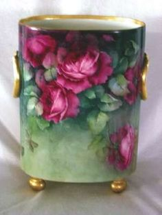 Limoges porcelain hand-painted floral cachepot trimmed in gold, 12 1/2 inches tall very interesting form