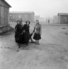 Female inmates at Bergen-Belsen concentration camp use a blanket to remove a corpse from their barracks following the liberation of the camp by the British 11th Armoured Division. Bergen-Belsen concentration camp, near Celle, Lower Saxony, Germany. 18 April 1945.