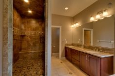 Master bathroom with walk in shower and dual sinks (1st floor)