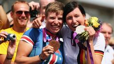 Bronze medallist Allison Jones (L) of the USA celebrates with silver medallist Denise Schindler of Germany after the women's Individual C1-3 Road Race on Day 8 of the London 2012 Paralympic Games at Brands Hatch.