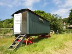 Downhouse Shepherd's Hut, Dorset. Our shepherd's hut is in a quiet location with a superb view out across the fields and Lyme Bay, just an easy stroll down to a quiet beach http://www.organicholidays.co.uk/at/2407.htm