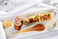 At Farrah Olivia, medallions of rabbit are joined by a painterly presentation of foie gras terrine and chorizo sauce. Photograph by Stacy-Zarin Goldberg.