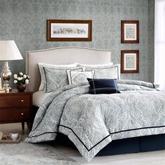 Create a sophisticated look in your bedroom with the Harbor House Naples Bedding Collection. Printed on 250 thread count cotton sateen, this navy blue paisley design provides the perfect contrast against the bright white background. Navy blue strapping creates an eye catching border around the comforter and shams while a pleated navy bedskirt creates a bold finish.