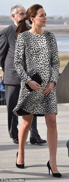 March 11, 2015 The Duchess of Cambridge was in Margate in Kent to visit the town's Turner Contemporary gallery and looked pretty in a Dalmatian print coat by Hobbs, one of the Duchess' favourite High Street brands, which was last worn to launch the Royal Princess cruise ship - her last visit before giving birth to Prince George.    1
