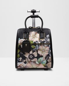Buy Ted Baker Inez Gem Gardens Travel Bag, Black from our Women's Handbags range at John Lewis & Partners. Ted Baker Bag, Ted Baker Dress, Hand Luggage Suitcase, Luggage Bags, Travel Luggage, Versace, Designer Travel Bags, Ted Baker Fashion, Rolling Bag