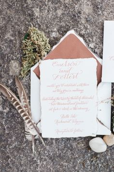 Wedding invitations - by Sincerely Amy Designs Calligraphy - leather lined envelopes - copper ink - feathers rocks leather and moss ~ Styled by Wright Event Services Photography: Andrea Pesce Photography - www.andreapesceph... Read More: www.stylemepretty...