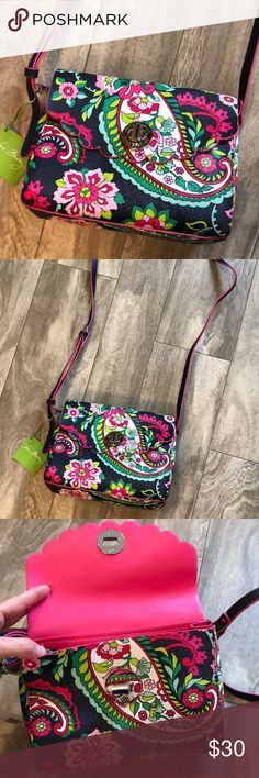 NWT Vera Bradley cross body purse 💕 Such a CUTE purse, especially the scalloped edges along the front opening. Navy blue with pinks and greens. Great for spring time! Inside is large and has two open spaces for storage along with a built in zippered compartment. Strap is adjustable. Never used still has tags and tissue paper inside. Bundle with any other item in my closet and save 20%! Vera Bradley Bags Crossbody Bags