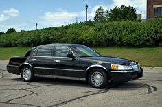 """Maybe blue or black. I didn't pay any attention to the license plate."""" Lincoln Town Car, Cartier L) Lincoln Town Car, Dark Colors, Concept Cars, Cartier, Automobile, Ford, Plate, Motorbikes, Motor Car"""