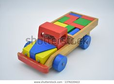 Find Colorful Wooden Truck Toy stock images in HD and millions of other royalty-free stock photos, illustrations and vectors in the Shutterstock collection. Wooden Crafts, Wooden Diy, Wooden Toy Trucks, How To Make Toys, Wood Stool, Backyard Games, En Stock, Jouer, Vintage Toys