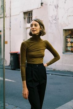 this shirt is an example of a turtle neck silhouette because of its high closed collar.