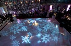 snowflake gobos on white dancefloor – looks like ice skating rink  I think one of our dancers would knock over a cake in the center of the dance floor!