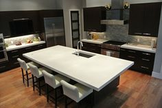 Modern kitchen design features a white concrete island top and countertops throughout. Featured 7/6/12.  Hard Topix Jenison, MI