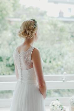 Loose twisted bridal updo with floral headband | Photo by Hanna Witte via http://junebugweddings.com/wedding-blog/delightful-german-wedding-red-accents/