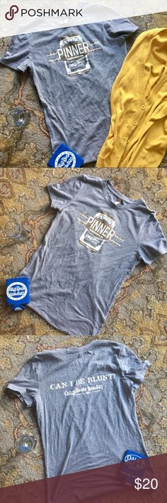 """Oskar Blues Brewery """"Can I Be Blunt?"""" Tee Oskar Blues is my all-time favorite craft brewery, an endorsement I don't make lightly.  Based out of Colorado, they decided to open a new location in Brevard, NC  5 years ago - so of course I had to visit. This fitted gray tee (for the Pinner IPA) was purchased on that pilgrimage. It's a ladies Large & has a very flattering fit. The brand of tee is Next Level & the fabric is a mix of 50% polyester, 25% cotton, & 25% rayon.  Length is 25"""" shoulder to…"""