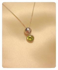 Fine silver clay pebble with peridot colour CZ drop.
