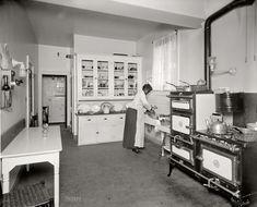 "The Modern Kitchen: 1920. Washington, D.C., circa 1920. ""Kitchen of Ernest G. Walker,"" newspaperman and real-estate developer. Harris & Ewing Collection glass negative. Nice details about kitchen furnishings."