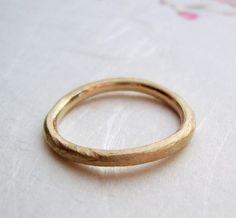 simple rough band in solid 10k yellow gold- mark of the maker- wedding ring. Probably too thick but I really like it. $140