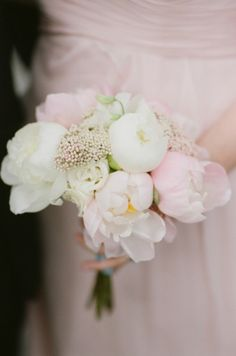Soft pink and white peonies for this bridesmaid: http://www.stylemepretty.com/rhode-island-weddings/2015/01/16/romantic-rhode-island-mansion-wedding/   Photography: Robert & Kathleen - http://www.robertandkathleen.com/