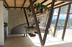 Tagged: Kitchen, Concrete Counter, and Range. Photo 3 of 8 in Stay in a Domed, Glass-Front Vacation Home in a Spanish Forest
