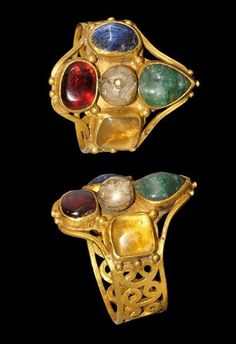 Byzantine Gold Ring, 6th -8th Century AD With cabochons of garnet, emerald, lapis lazuli, quartz and a central pearl.