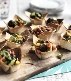 Make tortillas into fresh, crispy party nibbles filled with avocado, mango and beans.
