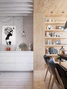 Le mur recouvert de bois permet de délimiter l'espace salle à manger par rapport à l'espace cuisine qui se trouve dans la même pièce. Une belle façon de créer un joli lieu pour manger quand on n'a pas de salle à manger.