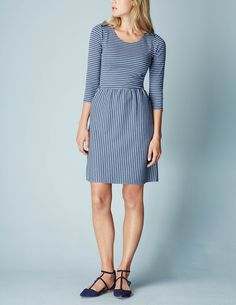 Our love affair with stripes continues. The fitted top, fuller skirt and classic colours make this a wear-anywhere favourite – and we love the exposed shoulder zips.