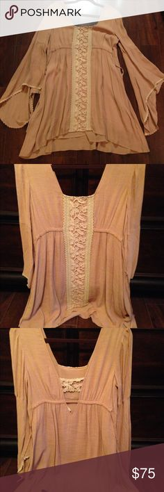 Free people boho dress Free people pinky/tan boho dress with Lacey accents. Long bell sleeves. New without tags. No damage. Smoke free home. Size small. Free People Dresses Mini