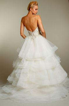 Jim Hjelm JH8155  Ivory irregular tiered Tulle Ball bridal gown, strapless crystal embroidered bodice, tulle skirt accented with horse hair edge, chapel train.