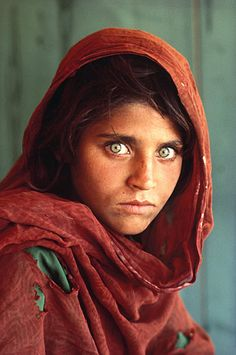 """Afghan Girl"" Photo  Photograph by Steve McCurry.     Afghan refugee camp in Pakistan in December 1984, National Geographic photographer Steve McCurry captured one of the most famous portraits the world had ever seen. The Afghan girl with the haunting green eyes captivated everyone. That captivation proved, once again, the power of photography to open eyes—and hearts and minds—with a single image."