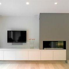 Coin télé dans salon épuré avec cheminée design - EXID photo n°47 - Domozoom