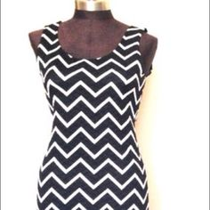 """Black/white Chevron Bodycon dress Worn once last Halloween, tag size L (fits 4/6) still in excellent condition. This dress is made of a thick polyester, 4% spandex, length is 36"""" Dresses"""