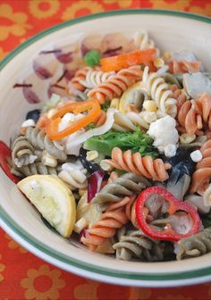 I love pasta salad, and we like a lot of vegetables in ours so this is definitely a meal in itself! Tri-color rotini adds extra nutrition and color but feel free to use any pasta you like!