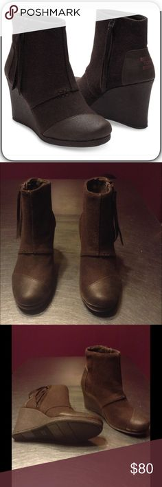 """Toms Desert Brown Wedge Elevate your look with these closed toe chocolate wedge bootie in durable wool pattern. Toms classic suede footbed deck with EVA insole. Zip closure at side for easy access. Perforated suede lining. 3.25"""" heel. Size 6.5 TOMS Shoes Ankle Boots & Booties"""