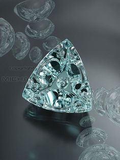 """Michael M. Dyber. of New Hampshire First prize winner of the most prestigious gemstone cutting competition in the world """"The 40th German Award for Jewellery and Precious Stones, Idar-Oberstein 2009"""" - with a 113.24 ct. Aquamarine cut so that it reflects optical illusions in three dimensions. It was completely cut by hand on equipment built by Michael in his New Hampshire studio."""