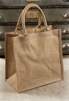 "19.00 SALE PRICE! . Burlap Bags with Handles 12x12 6 bags  for 6 bags. 12"" x 12"" x 7.75"" deep cotton handles. 6 bags per pack. Regular pr..."