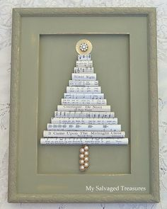 Christmas tree wall art made from vintage sheet music, bits and pieces of jewelry, and an old cabinet door. From MySalvagedTreasures.com