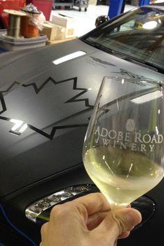Wine tasting among Aston Martin pro race cars at @adoberoad, Petaluma, California.