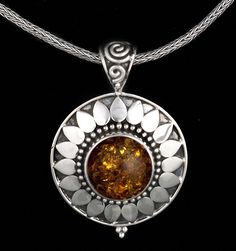 Sterling Silver Amber Sun Necklace featuring a Baltic Amber stone, handcrafted in Bali by Bluemoonstone Creations.
