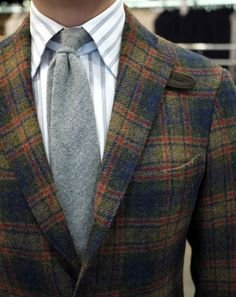 the blazer is smashing, yet the shirt & tie are not,  needs for contrast bowtie & no stripe