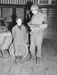 First Lt. Edward L Jarcynski, a military policeman of the US Infantry Division, questions a 15 year old youth captured in Veckerhagen, Germany, March Allied forces captured German POWs as young as Ww2 Pictures, Historical Pictures, Ww2 History, Military History, Man Of War, War Photography, Military Police, American War, German Army
