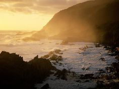 The webpage where I found this, reckons it's the Cape of Good Hope. H'mm, I'm not so sure. I think the image is of the shoreline at the Storms River rest camp, Tsitsikamma Section, Garden Route National Park. -ALV