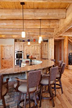 PERFECT KITCHEN ISLAND-Featured Log Home & Timber Frame Home Construction Projects by Wisconsin Log Homes - Wisconsin Log Homes